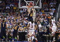 March 21st, 2013: California's Robert Thurman dunks the ball again during a game against UNLV at HP Pavilion, San Jose, California. California defeated UNLV 64 - 61