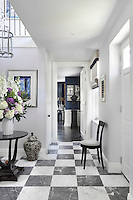 Black and white marble flooring in the light and airy entrance hall leads through to the reception room