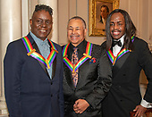 Members of the band Earth, Wind & Fire, from left to right, singer Philip Bailey, percussionist Ralph Johnson and bassist Verdine White, three of the recipients of the 42nd Annual Kennedy Center Honors pose for a group photo following a dinner at the United States Department of State in Washington, D.C. on Saturday, December 7, 2019. The 2019 honorees are: Earth, Wind & Fire, Sally Field, Linda Ronstadt, Sesame Street, and Michael Tilson Thomas.<br /> Credit: Ron Sachs / Pool via CNP