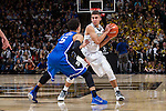 Mitchell Wilbekin (10) of the Wake Forest Demon Deacons is guarded by Tyus Jones (5) of the Duke Blue Devils during second half action at the LJVM Coliseum on January 7, 2015 in Winston-Salem, North Carolina.  The Blue Devils defeated the Demon Deacons 73-65.  (Brian Westerholt/Sports On Film)