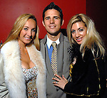 From left: Daphne and Alejandro Gomez with Jessica Stevenson  at the Houston Young People for the Arts Fire & Ice Gala at the Houston Pavilions Saturday Jan. 24, 2009.(Dave Rossman/For the Chronicle)