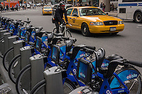 Bikes are lined up in their docking station in the East Village in New York on Saturday, May 25, 2013 in anticipation of the Monday roll-out of the city's bike-sharing program. 6000 bikes in over 300 stations await subscribers to the program. (© Richard B. Levine)