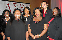 NWA Democrat-Gazette/CARIN SCHOPPMEYER Rachel Johnston (from left), Tiffany Hughes-Butler, Letitia Johnson, Aterra Lowe, Stephanie Adams and Catandra Johnson, Delta Sigma Theta Crimson and Cream committee members, gather at the scholarship benefit luncheon Feb. 18.