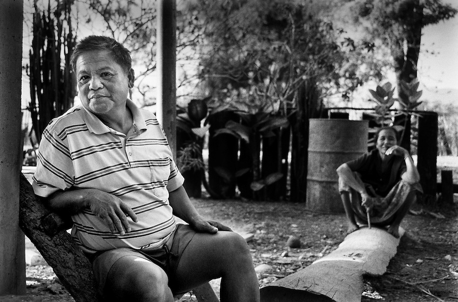 "Mekong Dam Victims - Laos. Mr. D.S. and his wife. The river has become inaccessible near their village because of fences put up by the dam company. The nearby regulation pond creates dangerous floodings in this area and people have lost their lives in this part of the river. After the construction of the Theun-Hinboun Dam in Laos more than 29,000 people in 71 villages have lost fisheries, rice fields, vegetables gardens and fresh drinking water supplies as a result of the dam. An expansion project is currently under construction and will displace another 4,200 mostly indigenous people from their lands in the reservoir area and displace or negatively affect another 50,000 people living downstream, on project construction lands, and in resettlement host villages. Known as ""The Mother of Waters"", more than 60 million people depend on the Mekong river and its tributaries for food, fresh water, transport and other aspects of daily life. The construction of big dams is now threatening the life of these people aswell as the vital and unique ecosystem of the river."