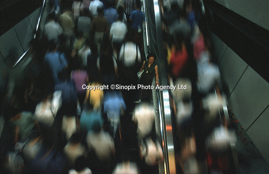Rush hour commuters throng Shanghai's People's Square Metro Station. The city's subway has been immensly successful since completion. .11-AUG-01