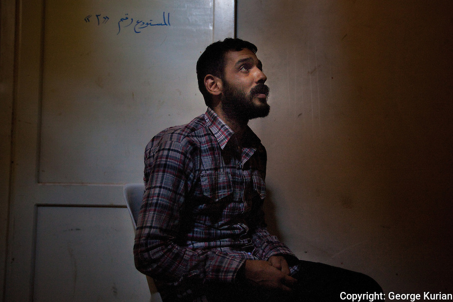 l0/08/20l2 Al Bab: Free Syrian Army Prison:<br /> This man was captured while allegedly carrying sniper bullets into Aleppo. <br /> He said he was an army veteran, caught while carrying out the errand at the behest of an ex comrade from his army days.