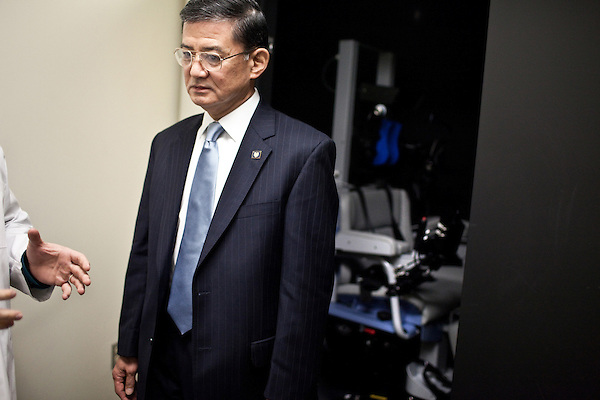 October 23, 2009. Durham, North Carolina.. Eric Shinseki, Secretary of Veterans Affairs for the Obama administration, visited Durham to meet with officials and veterans at the VA hospital, as well as to attend several events and meetings on the Duke University campus.. Sec. Shinseki took a tour of the VA hospital and looked at a rotating chair, background, that helps to diagnose patients who could be suffering from traumatic brain injury.