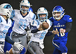 Jerseyville quarterback Matthew Jackson (center) runs a pitchout option as he gives the ball to running back Kurt Hall (far left). Also shown are Columbia's Matt Muehlher (10, right) and Jerseyville lineman Alex Strebel (71, left). Jerseyville played at Columbia on Friday October 19, 2018.<br /> Tim Vizer/Special to STLhighschoolsports.com
