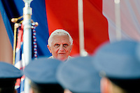 Pope Benedict XVI watches the Castle Guard during the welcome ceremony at the Prague Airport, Czech Republic, 26 September 2009.