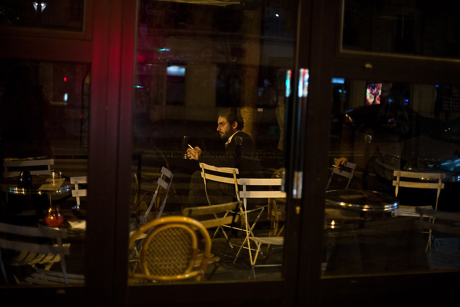 FRANCE, Paris: People in Paris are blocked in cafe's during the attacks in Paris. Shootings and blasts leave at least 120 dead in Paris