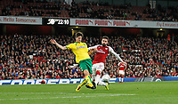 Timm Klose of Norwich City stops Olivier Giroud of Arsenal during the Carabao Cup match between Arsenal and Norwich City at the Emirates Stadium, London, England on 24 October 2017. Photo by Carlton Myrie.
