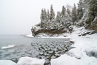 Small, round ice chunks floating in an icy Lake Superior cove. Marquette, MI