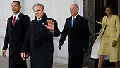 Washington, DC - January 20, 2009 -- Former United States President George W. Bush waves as he walks to a waiting helicopter alongside US President Barack Obama, US Vice President Joe Biden and First Lady Michelle Obama,after Obama was sworn in as the 44th US president at the US Capitol in Washington, DC, on January 20, 2009. .Credit: Saul Loeb - Pool via CNP
