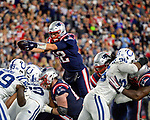 FOXBORO, MA. - OCTOBER 4: New England Patriots quarterback Tom Brady leaps the line of scrimmage to score a touchdown against the Colts in the second quarter of an NFL football game at Gillette Stadium in Foxboro, Massachusetts on October 4, 2018. Photo By Christopher Evans