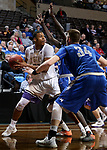 SIOUX FALLS, SD - MARCH 8:  Aziz Leeks #22 of the College of Idaho looks past Mayville State defenders Garek Droog #34 and Gorgeous Alhag #23 at the 2018 NAIA DII Men's Basketball Championship at the Sanford Pentagon in Sioux Falls. (Photo by Dave Eggen/Inertia)
