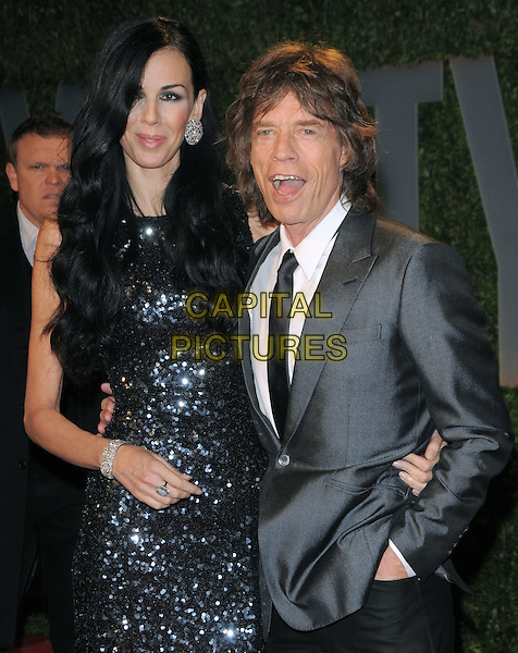 L'WREN SCOTT & MICK JAGGER.The 2009 Vanity Fair Oscar Party held at The Sunset Tower Hotel in West Hollywood, California, USA..February 22nd, 2009.oscars half length grey gray suit jacket black tie sequined sequins shiny sparkly dress beaded couple mouth open .CAP/DVS.©Debbie VanStory/Capital Pictures.