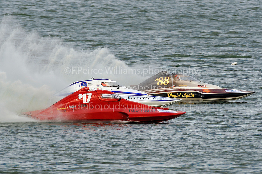 """(Front to Rear): Keith Anderson, S-17 """"Bad Habit"""" (2.5 Litre Stock hydroplane), Mark Johnson, S-9 """"Rewinder"""",  2.5 Litre Stock class hydroplane and S-88 """"Playin Again,  2.5 Litre Stock class hydroplane."""