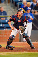 Virginia Cavaliers catcher Nate Irving #18 checks the runner at first during the game against the Duke Blue Devils at Durham Bulls Athletic Park on April 20, 2012 in Durham, North Carolina.  The Blue Devils defeated the Cavaliers 6-3.  (Brian Westerholt/Four Seam Images)