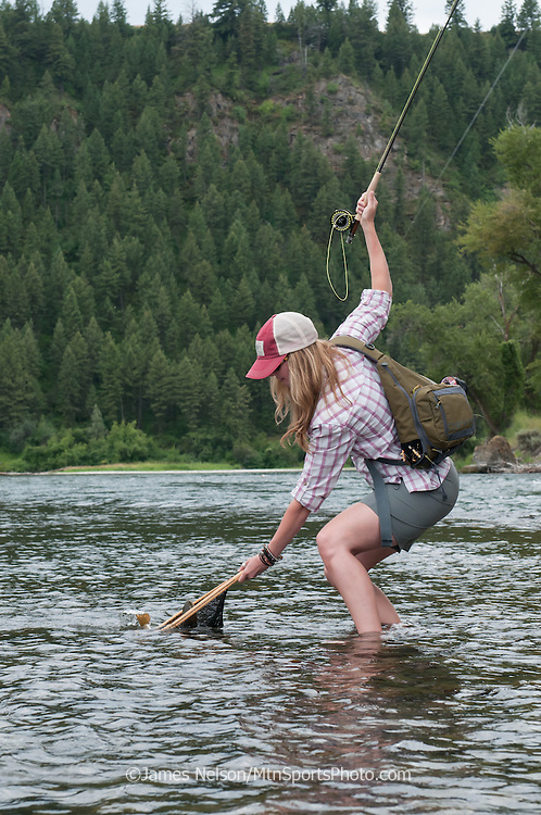 Alexis Metcalf nets a cutthroat trout while fly fishing on the South Fork of the Snake River, Idaho.