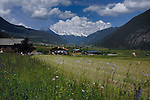 View of meadows and mountains, towards small village of Tarranz in the background.Imst district, Tirol,Tyrol, Austria.