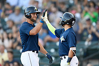 Designated hitter Tim Tebow (15) of the Columbia Fireflies is congratulated by Michael Paez after scoring a run in a game against the Lexington Legends on Thursday, June 8, 2017, at Spirit Communications Park in Columbia, South Carolina. Columbia won, 8-0. (Tom Priddy/Four Seam Images)