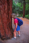 hiker smelling pine tree
