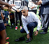 Sadiq Khan, Mayor launches Thrive LDN to challenge mental health stigma and improve care<br /> 4th July 2017<br /> at <br /> The Unity of Faiths Foundation (TUFF) FC football pitches at Stepney Green Park Astroturf, London, Great Britain <br /> <br /> The mayor was presented with some football boots with his name on.<br />  <br /> The Mayor will visit TUFF FC (The Unity of Faiths Foundation) to launch Thrive LDN. TUFF FC is a football-based education project, designed to support youth integration and improve the mental well-being of young people. By bringing together children of different faiths and backgrounds, TUFF FC aims to combat issues such as drug addiction, extremism, isolation, gang involvement and knife crime early to prevent young people from developing poor mental health.<br /> <br /> <br /> Photograph by Elliott Franks <br /> Image licensed to Elliott Franks Photography Services