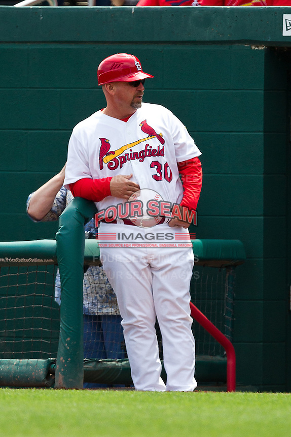 Hitting Coach Phillip Wellman (30) of the Springfield Cardinals stands in the dugout during a game against the Arkansas Travelers at Hammons Field on May 8, 2012 in Springfield, Missouri. (David Welker/ Four Seam Images)