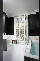 The bath, washstand and floor of this bathroom are all made from grey-veined Carrara marble and the floor is constructed of marble spars, all of unequal width