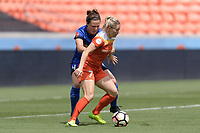 Houston, TX - Saturday May 27, 2017: Kealia Ohai (7) of the Houston Dash and Rachel Corsie (4) of the Seattle Reign FC battle for control of the ball during a regular season National Women's Soccer League (NWSL) match between the Houston Dash and the Seattle Reign FC at BBVA Compass Stadium.