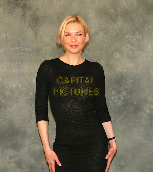 """RENEE ZELLWEGER .Photocall for film """"Leatherheads"""" ( Italian - 'In amore niente regole"""" ).in Rome, Italy, April 10th 2008..half length black dress sheer sweater patterned .CAP/CAV.©Luca Cavalari/Capital Pictures"""