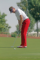 Ian Poulter eyes up his putt on the 3rd.on day one of the Dubai World Championship on the Earth Course at the Jumeirah Golf Estate, Dubai..Picture Fran Caffrey/www.golffile.ie.
