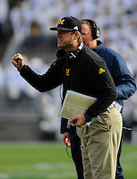 21 November 2015:  Michigan head coach Jim Harbaugh cheers after a touchdown. The Michigan Wolverines defeated the Penn State Nittany Lions 28-16 at Beaver Stadium in State College, PA. (Photo by Randy Litzinger/Icon Sportswire)