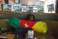Hartford, CT - Friday June 13, 2014: Cameroonian Joyce Ashuntantang watches the Cameroon vs. Mexico FIFA World Cup first round match at Damons Tavern in Hartford, CT.