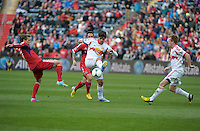New York midfielder Juninho (8) plays the ball in front of Chicago midfielder Chris Rolfe (17).  The Chicago Fire defeated the New York Red Bulls 3-1 at Toyota Park in Bridgeview, IL on April 7, 2013.