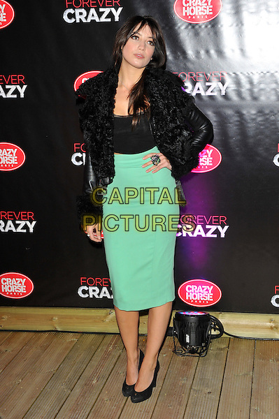Daisy Lowe.Forever Crazy by Crazy Horse VIP Gala Night at South Bank, London, England..September 19th 2012.full length green skirt hand on hip black leather jacket top.CAP/CJ.©Chris Joseph/Capital Pictures.