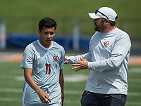 NWA Democrat-Gazette/BEN GOFF @NWABENGOFF<br /> D.J. Beeler, Springdale head coach, talks with Salvador Gonzalez Saturday, May 12, 2018 during the semifinal match against Fort Smith Northside in the boys 7A state soccer tournament in Gates Stadium at Rogers Heritage.