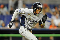 7 March 2012:  FIU shortstop Julius Gaines (2) hits a double in the sixth inning as the Miami Marlins defeated the FIU Golden Panthers, 5-1, at Marlins Park in Miami, Florida.