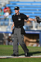 Umpire Brandin Sheeler signals foul ball during a game between the Vermont Lake Monsters and Jamestown Jammers on July 13, 2014 at Russell Diethrick Park in Jamestown, New York.  Jamestown defeated Vermont 6-2.  (Mike Janes/Four Seam Images)