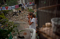 In 2012 Rio de Janeiro authorities closed down a garbage dump known as Gramacho Garden  (Jardim Gramacho) in Duque de Caxias, outskirts of the city, as requested by the Olimpic Games comitee for 2016 Games. They promised urban developments and the cleaning of the area for the better of the dwellers. After 5 years, promises are gone with the wind and the garbage reappeared in the place. People got back to dig in the garbage to survive. A clear example on how governments can spend astronomic sums of money in the infrastructure of a few weeks lasting Olympic Games, without working out at all the problem of poverty.