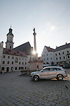 Audi Q7 in Freising, Germany square as the sun sets on another day.