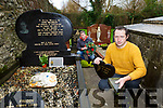 Donal Ryan at his brother Freddy grave and Peter Carty are appalled at the vandelism to the graves in the Invyleaf graveyard Castleisland on Saturday evening