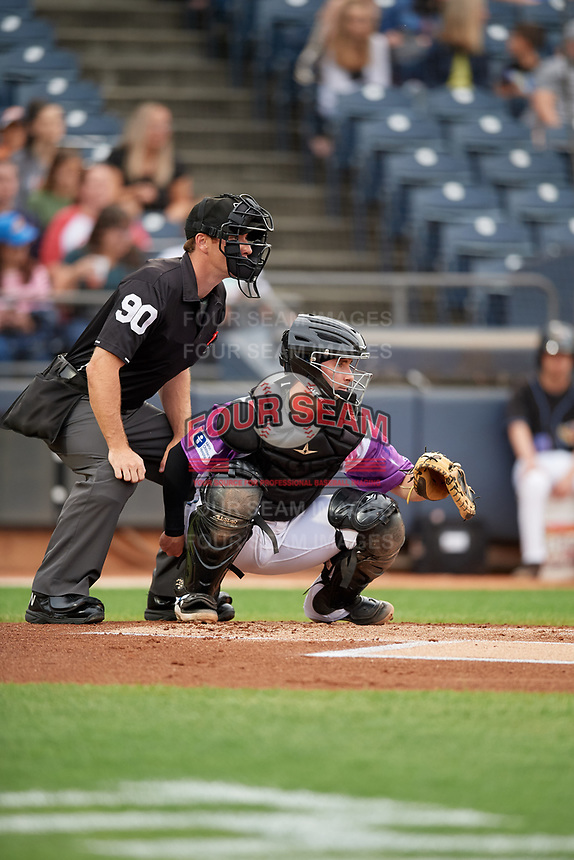 """Umpire Tom Hanahan and Akron RubberDucks catcher Logan Ice (9) during an Eastern League game against the Erie SeaWolves on August 30, 2019 at Canal Park in Akron, Ohio.  Akron wore special jerseys with the slogan """"Fight Like a Kid"""" during the game for Akron Children's Hospital Home Run for Life event, the design was created by 11 year old Macy Carmichael.  Erie defeated Akron 3-2.  (Mike Janes/Four Seam Images)"""