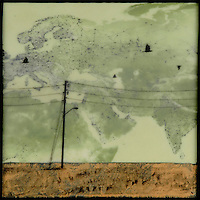 Encaustic painting over satellite image with birds flying in field with telephone poles