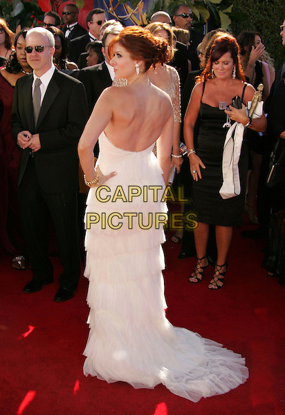 DEBRA MESSING.58th Annual Primetime Emmy Awards held at the Shrine Auditorium, Los Angeles, California, USA..August 27th, 2006.Ref: ADM/RE.full length white dress strapless layers hands on hips back behind rear profile.www.capitalpictures.com.sales@capitalpictures.com.©Russ Elliot/AdMedia/Capital Pictures.