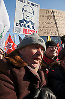 Moscow, Russia, 10/03/2012..Demonstrators chant slogans as up to  20,000 people protest in central Moscow against Vladimir Putin's victory in the Russian presidential election.