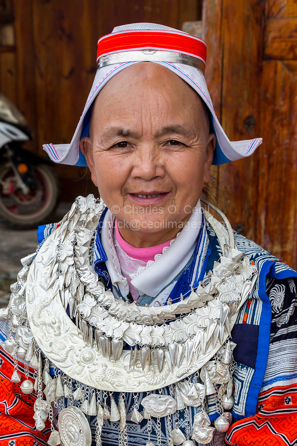 Matang, a Gejia Village in Guizhou, China.  Middle-aged Woman Wearing Traditional Clothing, Necklace, and Jewelry.