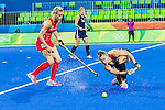 Katelyn Falgowski #23 of United States passes the ball before Alex Danson #15 of Great Britain arrives during Great Britain vs USA in a women's Pool B game at the Rio 2016 Olympics at the Olympic Hockey Centre in Rio de Janeiro, Brazil.
