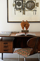 An arrangement of a retro desk and chair and post-war British art makes a stylish combination.