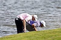 March 28, 2009, Arnold Palmer Invitation.   Tiger Wood, Vaughn Taylor looks for Woods ball on the 18th hole during third round play  at Bay Hill Golf Club in Orlando, Florida...